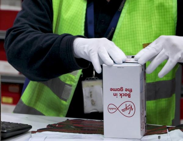 Customer device packaged for return
