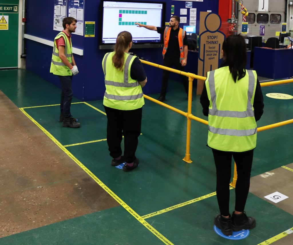 Unipart colleagues practicing safety at work