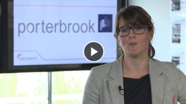 A women being interviewed in an office in front of a Porterbrook logo