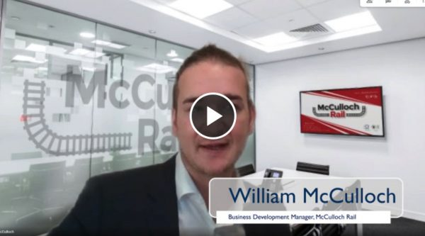 William McCulloch being interviewed in an office