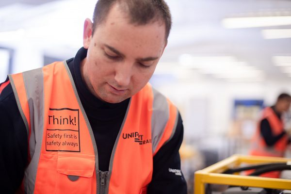 Unipart colleague wearing safety first jacket