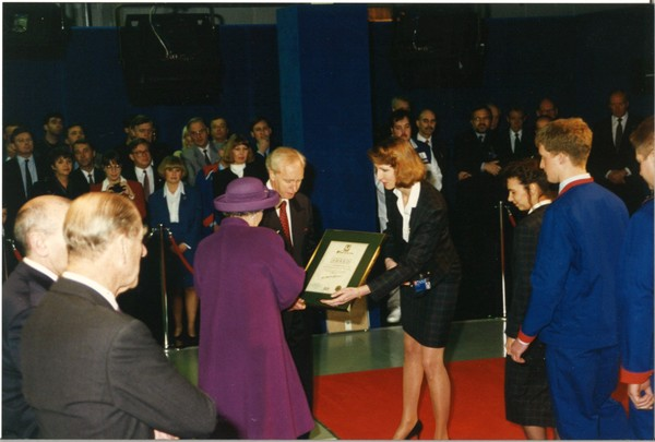 The Queen receives a certificate from John Neill at Unipart in March 1995 as HRH Duke of Edinburgh looks on