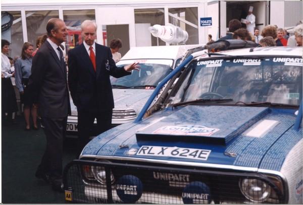 HRH Duke of Edinburgh and John Neill next to a rally car at Unipart June 1995