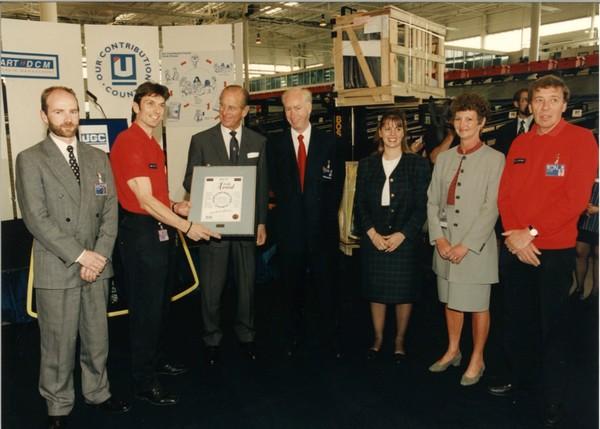 HRH Duke of Edinburgh presents an award to John Neill and Unipart employees in June 1995